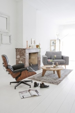 black-eames-lounge-chair-in-a-white-light-living-room-fire-place-grey-love-chair