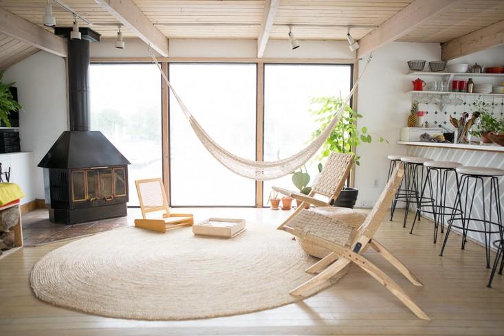 hammock-near-the-window-of-a-house-boat