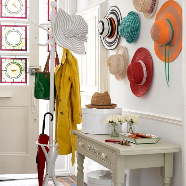 scandinavian-hallway-design-with-white-interior-color-decorating-ideas-plus-small-wooden-table-with-drawer-and-wood-umbrella-stand-combined-with-bag-hat-and-clothing-hooks